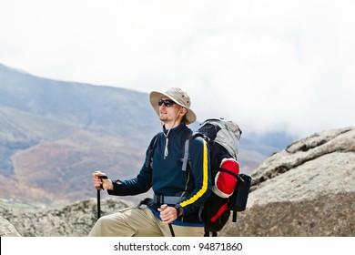 Man on trekking trip in Himalaya Mountains, sports in Nepal nature