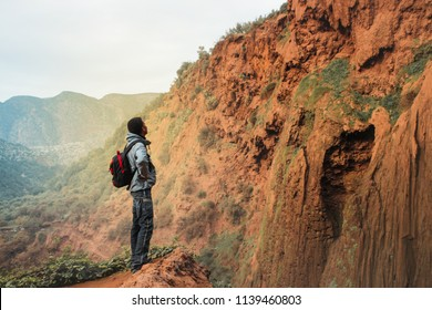 Man on a trip in the mountains.