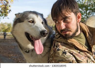 man on a walk with a dog