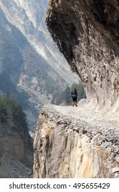 man on the way, rock and road in round Annapurna circuit trekking trail, Nepal