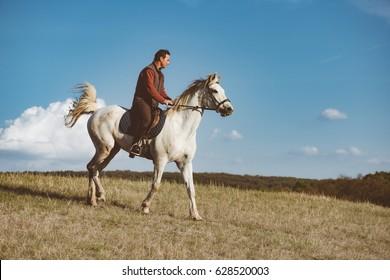 Man on white horse