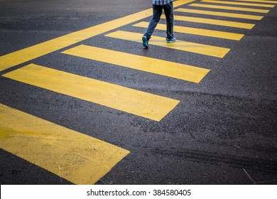 Man on zebra crossing.