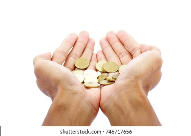 a man open hand with coins isolated on a white background