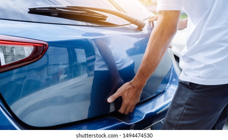Man open hatchback car for trunk his press button transportation technology system convenient, Vehicle and  automotive travel road trip in the holiday lifestyle on summer vacation concept