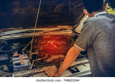 man opened car bonnet to see car engine over heat for repair , broken car concept.