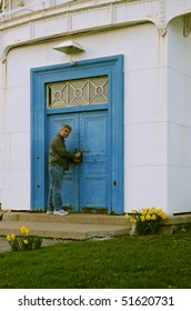 Man opening blue metal door