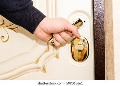Man is opening the door in his apartment