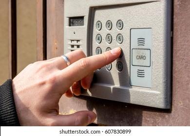 Man is opening door with intercom