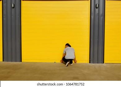 Man opening the shutter door