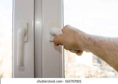 Man is opening the window