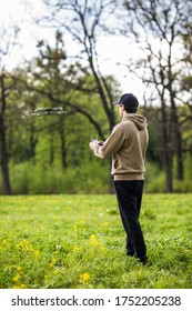 Man Operating Drone Flying or Hovering by Remote Control