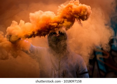 Man in orange smoke grenade