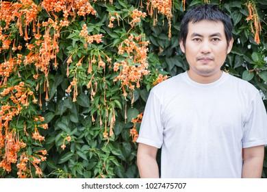 Man with Orange trumpet is which  a flower  bouquet.