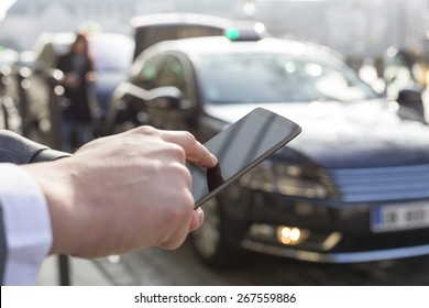 Man orders a taxi from his cell phone. Close-up hands