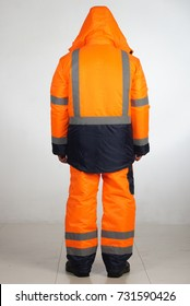 A man in overalls and work wear.Isolated studio portarit