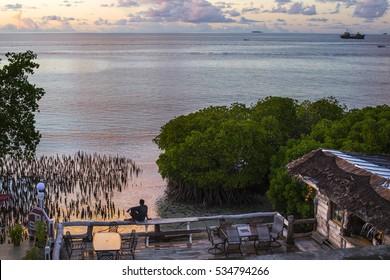Man overlooking the sunset on Chuuk Island