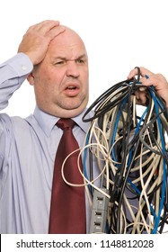 A man overwhelmed by a tangle of communications cables.