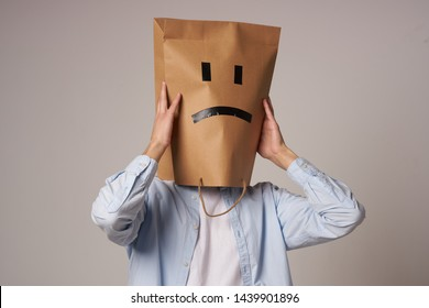 man with a package on his head depression