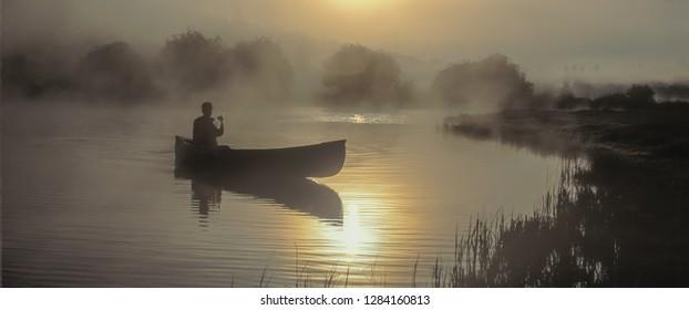 A man paddling a canoe on a lake near Sisters, Oregon
