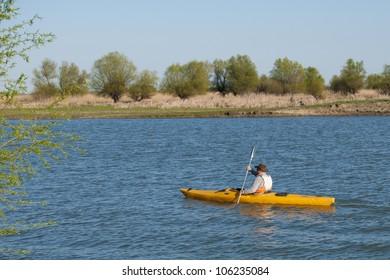 Man paddling in Kayak in Danube Delta
