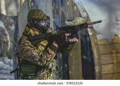 A man with a paintball marker is played on the field