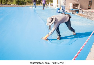 The man painting floor.