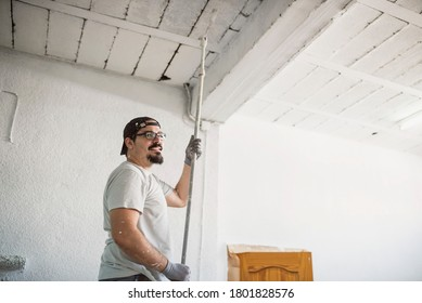 Man painting garage in realistic scene