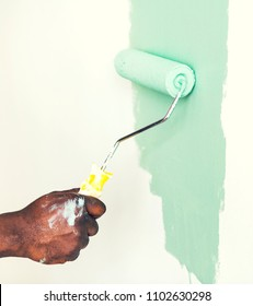 Man painting the wall green
