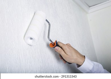 Man painting the wall, making reform