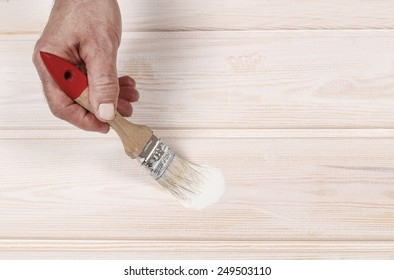 Man painting wood