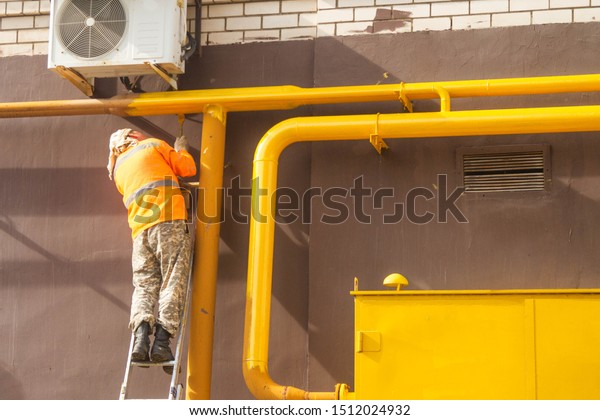 Man Paints Gas Pipe Yellow Paint Stock Photo Edit Now