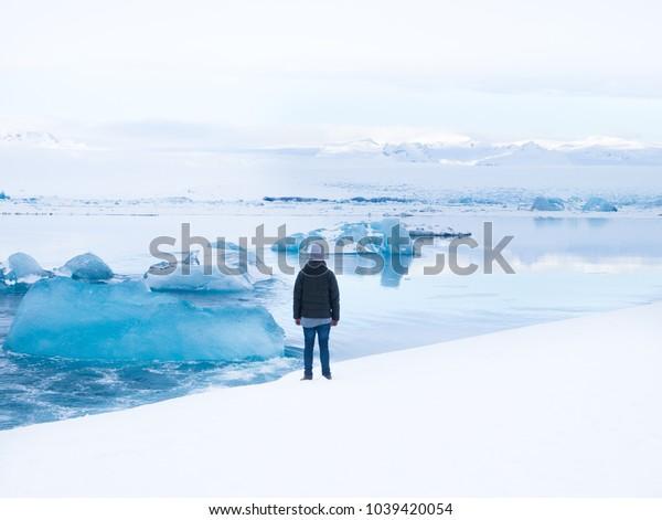 Man at the Panorama of the Glacier Lake Jökulsarlon in Iceland