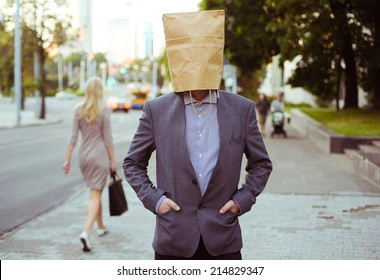 Man with paper bag on the head in the street