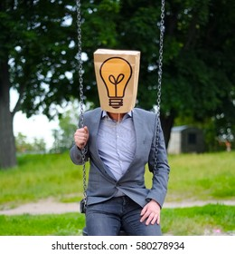 man with paper bag on the head