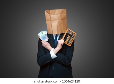 Man with paper bang on the head holding euro money and wooden calculator