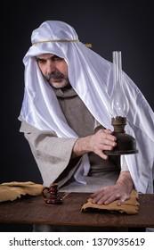 A man with paranormal abilities repels a levitating kerosene lamp