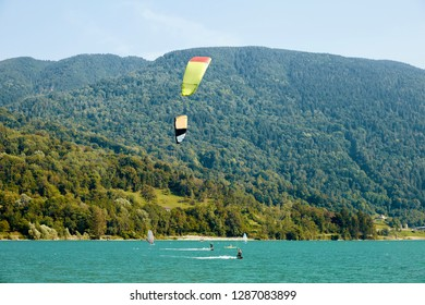 Man parasailing on Santa Croce Lake. Mountains on background. Province of Belluno, Italy