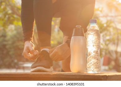 Man in a park and bottle of water with smartwatch