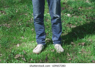 man in the park is standing on the grass. Waist up to the waist