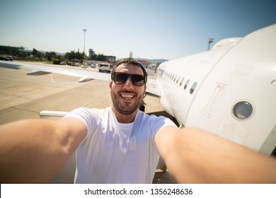 man passenger smile happily in the airplane, ready for flight taking selfie