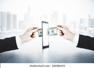 A man passes another man money through smartphone, online money transfer concept