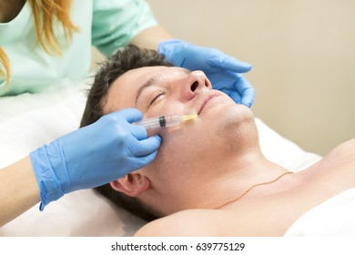 Man passes a course of mesotherapy clinic