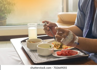 man patient hands eating hospital food for diabetes