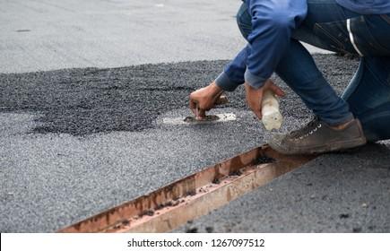 man pave building process running track floor