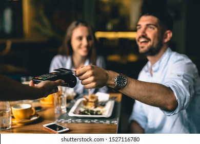 man paying bill at fancy restaurant
