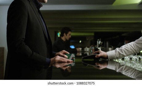 Man paying the bill. Stock. Businessman pays the bill by card at the restaurant