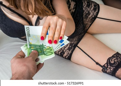 Man paying prostitute for sex - prostitution and escort concept