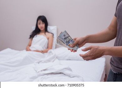 Man pays a prostitute with money dollar. Prostitute concept
