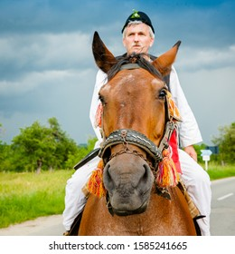 A man in a peasant costume riding a horse near Sibiel contry, Calusarii din Sibiel, Romania.