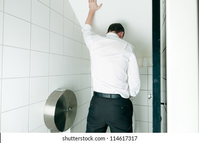 Man peeing in toilet